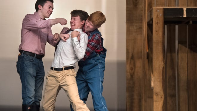 """Students of Sacred Heart of Jesus High School and St. Mary's School rehearse a scene from this year's family-friendly production, """"Charlotte's Web"""" on Thursday, Feb 1, 2018, at the Ned R. McWherter Cultural Arts auditorium in Jackson."""