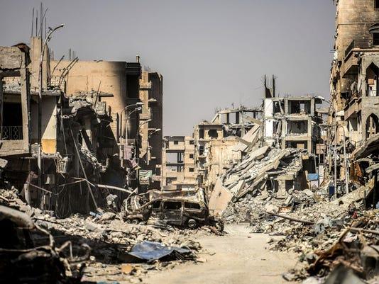 TOPSHOT-SYRIA-RAQA-CONFLICT