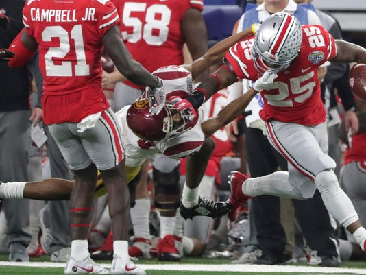 Ohio State running back Mike Weber (25) tries to shake off Southern California cornerback Isaiah Langley during the first half of the Cotton Bowl NCAA college football game in Arlington, Texas, Friday, Dec. 29, 2017. (AP Photo/LM Otero)