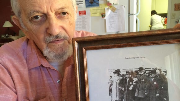 Holocaust survivor Edward Heisler, with a picture showing