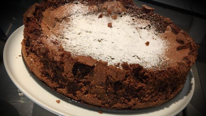 "Use ""really good"" chocolate and fresh eggs, Martha Hoover advised. Garnish the cake with nothing more than a dusting of confectioners' sugar."