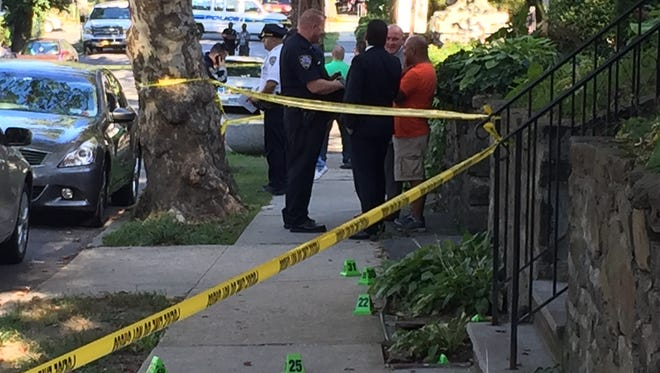Police investigate a shooting involving NYPD officers near Beekman and Tecumseh avenues in Mount Vernon on Aug. 28, 2015. A bystander, Felix Kumi, 61, of Mount Vernon, was fatally injured.