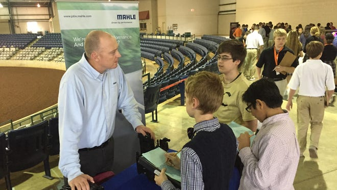 Jeff Clark, operations excellence manager for MAHLE, spoke with Central Magnet School students Fant Smith, Vahj Patel and Kevin Gosart at the inaugural Rutherford County Career Day at Miller Coliseum last year. This year's fair is set for Nov. 1. Vendor applications will be accepted until Oct. 20.