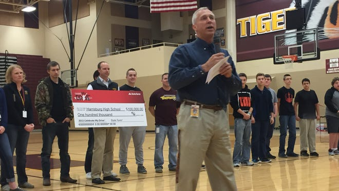 Harrisburg High School principal Dr. Kevin Lein addresses the student body after it won $100,000 from State Farm Insurance.