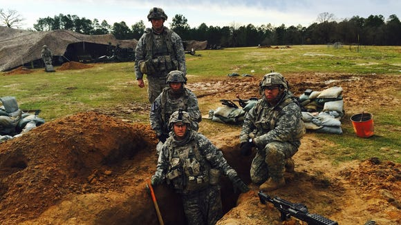 Members of 2nd Platoon, Bravo Battery, 2nd Battalion, 3rd Field Artillery Regiment dig a new fighting position to replace one that was flooded.