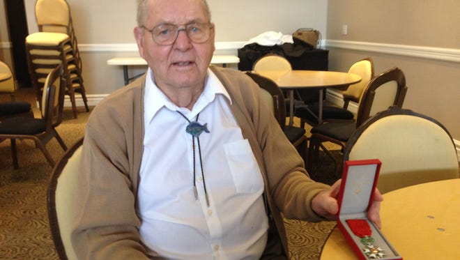 Don Jacot, 92, shows the medal indicating his status as a knight in France's Legion of Honor.