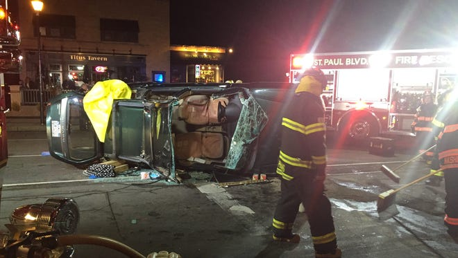 Firefighters extricated a woman after a rollover crash at the intersection of Cooper Road and Titus Avenue in Irondequoit on Friday night.