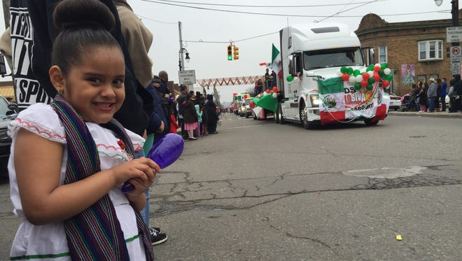 5-year-old Valery Ferreira couldn't march in the Cinco de Mayo parade, even though she dressed for it. Her mother had to work soon after the festivities. So Valery danced and snatched candy thrown from people on floats along Vernor Highway in southwest Detroit on May 1, 2016.