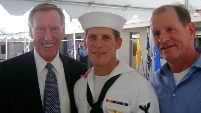 Charlie Keating IV, center, at his Navy SEAL graduation in 2008. At left is his grandfather, Charles Keating Jr. At right is his father, Charles Keating III.