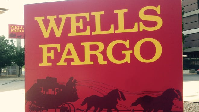 A Wells Fargo sign at the bank's branch on 7th Street and Mulberry Street in downtown Des Moines.