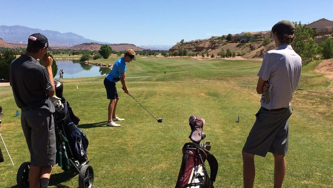 Dixie's Jack ... hits off the tees at SunRiver Golf Club on Tuesday. Beaver's Davis Heslington (left) took home medalist honors after firing a 4-over 75.