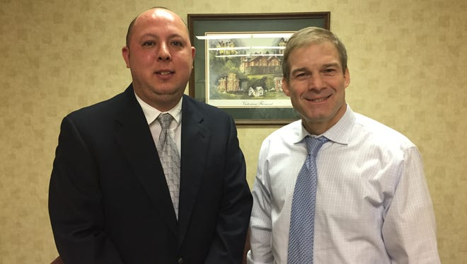 U.S. Rep. Jim Jordan of the 4th Congressional District visits with Fremont Mayor Danny Sanchez during a tour of his district on Monday.