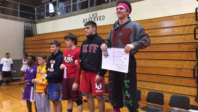 Richmond's Alston Bane (left) repeated as North Central Conference champion at the 160-pound weight class Saturday at Logansport.