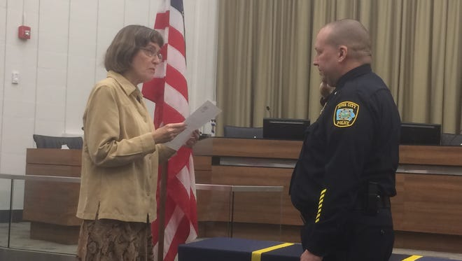 Jody Matherly, right, was sworn in as Iowa City's 46th police chief by Deputy City Clerk Julie Voparil on Monday, Jan. 23, 2017.