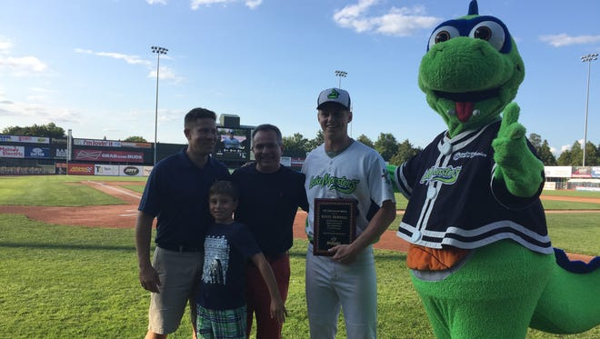 Kevin Merrell, this year's recipient of the Tom Racine Award, poses with Lake Monsters vice president Kyle Bostwick, far left, and FreePressMedia president Jim Fogler, second from left, and his son, Andrew, during Saturday's presentation at Centennial Field.