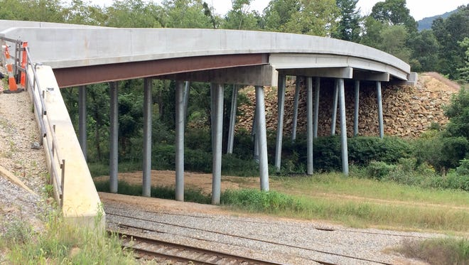 This 5-lane, $3.5 million bridge will lead to the proposed Enka Center development, which will include ball fields and a retail/commercial development.