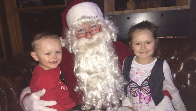 Owen Dougherty, 2, and Eliana Dougherty, 4, with Santa Dec. 18, 2017 at Diamonds Steak and Seafood Restaurant in Howell.