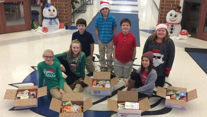 This group of Crestline students spearheaded a drive to create Care Packages for deployed troops. From left, are Sarah Smith, Kensie Pitt, Carter Johnston, Derek McCunn, Brock Rowe, Maradath Engler and Natalie Guiler. (Missing Brianca Clark).
