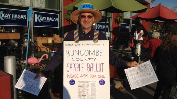 Local retiree Richard Wasch was a volunteer at a Democratic event held in North Asheville Tuesday morning aimed at getting people to cast ballots during the early voting period.