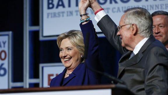 Senate Minority Leader Harry Reid and Hillary Clinton on stage at a dinner in Las Vegas on Jan. 6, 2016.