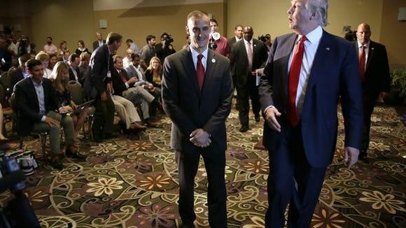Center: Corey Lewandowski. Right: Donald Trump. Not