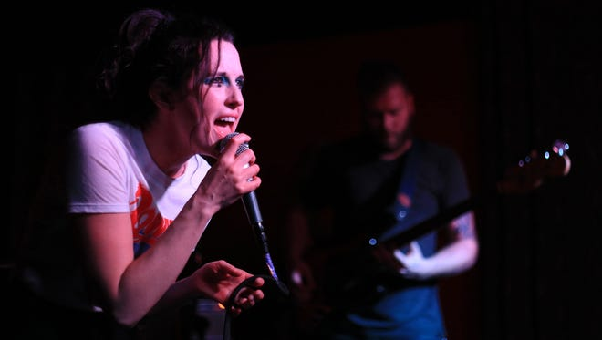 Kaitlin Sevy and Ryan Groskreutz of Zangiev perform Saturday during Jazzy's Rock and Roll Rumble in St. George. Zangiev took home first place in the battle of the bands.