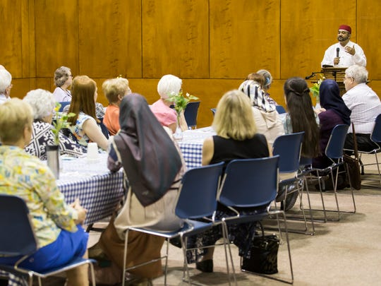 Dr. M. A. Muqtedar Khan speaks at an interfaith dinner and discussion at the Westminster Presbyterian Church in Wilmington on Sunday evening. After the terror attack a nightclub in Orlando, the evening's dinner became a discussion between members of the Muslim and Christian communities the Muslim faith and community building.