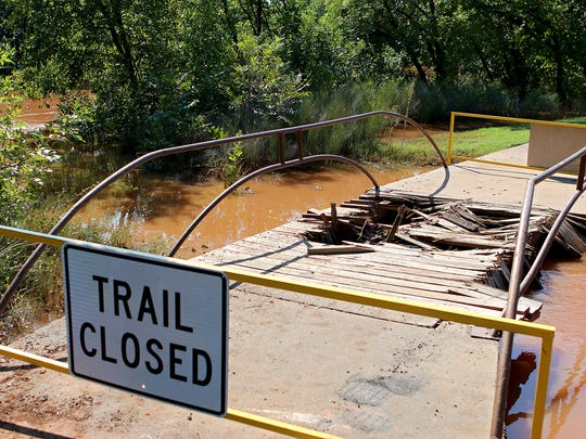 A wooden bridge along the hike and bike trial through Lucy Park is temporarily closed after a man drove his truck over it Sunday morning, causing about $4,500 worth of damage.