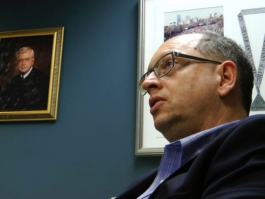 In this March 20, 2018, frame from video, Jefferson County Circuit Judge Robert Vance talks in his office in Birmingham, Ala., near a portrait of his father, slain U.S. Circuit Judge Robert S. Vance. The elder Vance was killed by a package bomb delivered to his home in 1989, and Vance says he feels empathy for victims of a string of bombings in Austin, Texas.