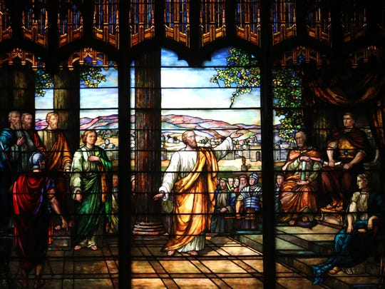 Stained glass windows can be seen throughout the church.