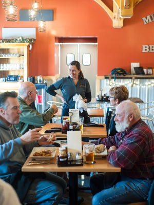 Vermont's consumption taxes — sales, meals and rooms, and the liquor and wine tax — were all up by between 5 and 6 percent compared to last year. Seen here is co-owner Joyce Fitzgerald and patrons in the dining room at Mill River Brewing BBQ and Smokehouse in St. Albans in December.