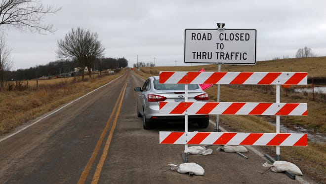 Lawrence County Highway M is closed between Halltown and Everton as crews work to clean up an oil pipeline spill.