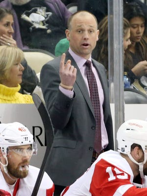 Detroit Red Wings coach Jeff Blashill gestures behind the bench against the Pittsburgh Penguins at the CONSOL Energy Center.