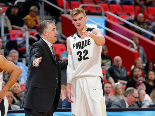 Mar 16, 2018; Detroit, MI, USA; Purdue Boilermakers head coach Matt Painter talks with forward Matt Haarms (32) in the second half against the Cal State Fullerton Titans  in the first round of the 2018 NCAA Tournament at Little Caesars Arena. Mandatory Credit: Rick Osentoski-USA TODAY Sports