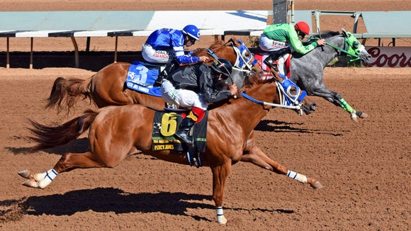 By By JJ Limited Partnership's Running Dragan ran her record to four wins, including two futurity scores, from four starts with a solid victory in the $364,256 Mountain Top Futurity for New Mexico-breds on Saturday afternoon at Ruidoso Downs.