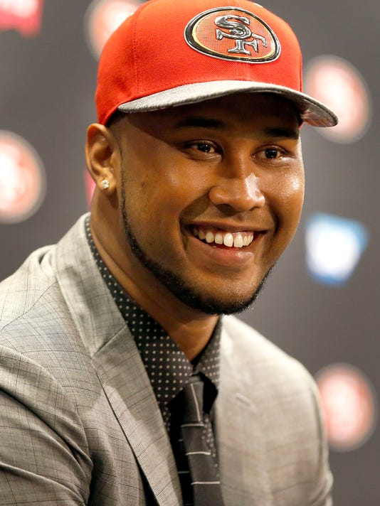 San Francisco 49ers first-round draft pick DeForest Buckner, rom Oregon, smiles as he answers questions during an NFL football news conference in Santa Clara, Calif., Friday, April 29, 2016. (AP Photo/Tony Avelar)