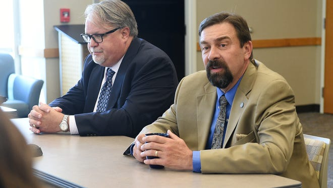Tony Frank, the president of Colorado State University, right, speaks to the Coloradoan Editorial Board in this file photo. He warned the Board of Governors on Thursday that CSU could take a hit to its bond rating.
