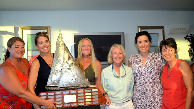 From left Super Duck winning crew, Jessica Yaeger, Catie Yaeger, skipper Susan Danielson, Phyllis Fromherz, Jeanne Herman, Celeste Thorson.  Not pictured, Snoann Willett.