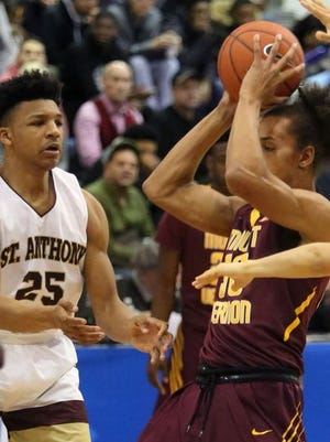 Ithiel Horton (25, on left) moves in to play defense during a St. Anthony's game.