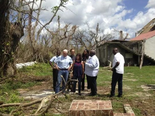 Vice President Mike Pence, joined by his wife Karen Pence, fourth from left, surveys hurricane damage outside Holy Cross Episcopal Church in St. Croix, U.S. Virgin Islands on Friday, Oct. 6, 2017. The church suffered extensive damage, including large holes in the roof.
