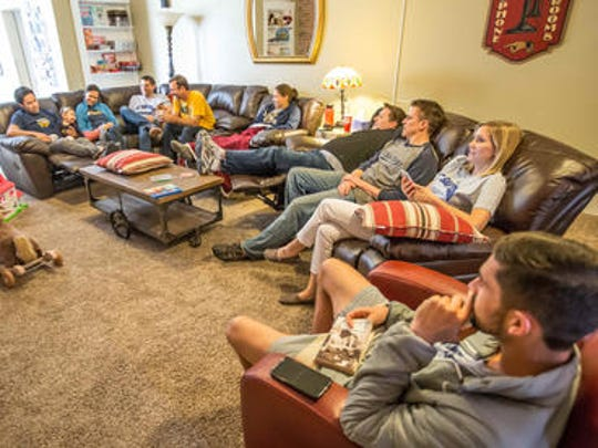 Former swimmers for the University of California-San Diego alumni are shown hanging out in a rented home in Lockerbie Square in Indianapolis. They couldn't find a hotel in town because of the Big Ten Men's Basketball Championship taking place the same weekend.
