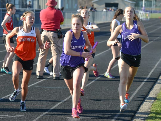 Avery Truex of Lakeview receives the baton from teammate Talar Coyer during the 3,200-meter relay.