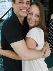 Actor Christian LeBlanc hugs Soapfest sponsor Lisa Lynch in 2016.