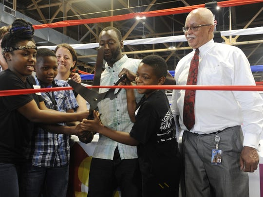 From left, Jamaria Monroe, Quintin Love, Detroit Boxing Gym Executive Director Jessica Hauser, founder Khali Sweeney, Chris Roberts, and Wayne County Executive Warren Evans attend ribbon-cutting ceremony.