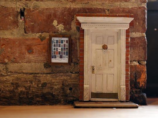 Opening the secrets behind fairy doors in ann arbor for Idea behind fairy doors