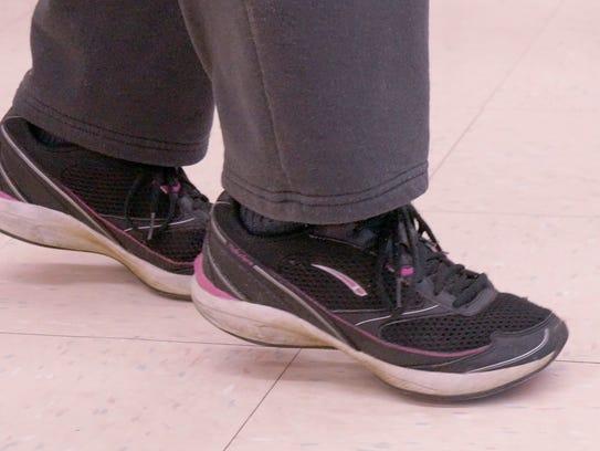 Jody Graziotti walks on her toes.