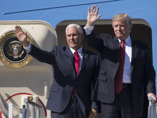 President Trump and Vice President Pence wave to supporters at Phoenix Sky Harbor International Airport on Aug. 22, 2017.