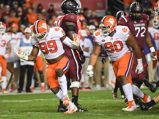 Clemson defensive end Clelin Ferrell (99), left, and Clemson defensive lineman Dexter Lawrence (90) celebrates a sack by Ferrell during the second quarter in Williams-Brice Stadium in Columbia on Saturday.