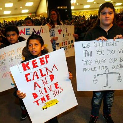 Lakewood students show their signs to board of education