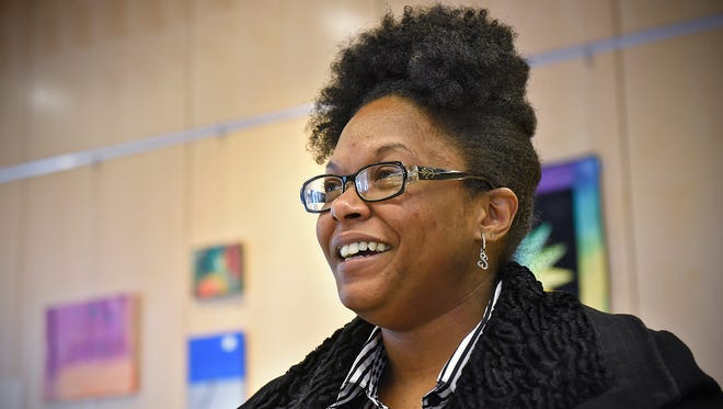Brandie Harrison talks about her experiences in the Catholic Charities Domus Transitional Housing program Thursday, Dec. 17 during an interview in St. Cloud.